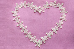 Romantic lacy heart on pink background Stock Image