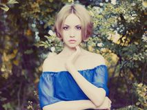 Romantic lady in the garden Stock Photos