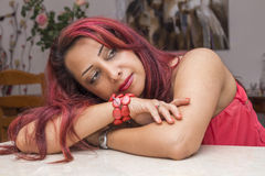 Romantic lady in red staring royalty free stock images