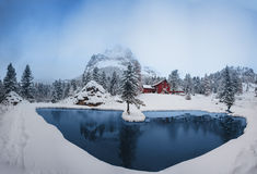 Romantic lake in the Dolomites. Romantic lake with snowy Christmas atmosphere in the Dolomites Stock Photo