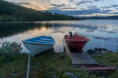 Romantic lake landscape in europe. Boats and water in silence and romance Europe travel Stock Photography