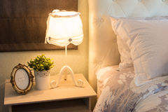 Romantic lamp at the bed Stock Photography