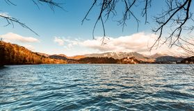 Romantic landscape at Lake Bled in Slovenia. Winter scenery sunny day, view of the church in the middle of the lake. Panorama. Romantic landscape at Lake Bled in royalty free stock image