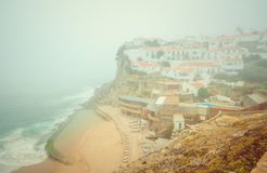 Romantic landscape of Praia das Azenhas do Mar. Sintra, Portugal. Praia das Azenhas do Mar beach in Colares, Portugal, on a foggy day. Beautiful view of the stock photography