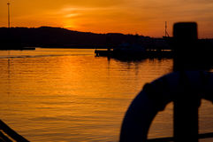 The romantic landscape of seaport in the Golden sunset hour. Royalty Free Stock Photography