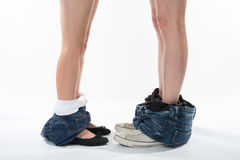 Romantic Legs and shoes of a man and woman with clothes down Stock Image