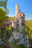 Romantic Lichtenstein Castle on the rock in Black Forest, German. Romantic Lichtenstein castle with fancy decorated towers sitting on a rock in Black Forest stock photography