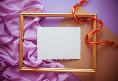 Romantic lilac background with frame,drapery and copy space for. Bright colorful background for designs and greeting cards Royalty Free Stock Photo