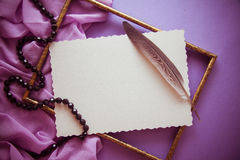 Romantic lilac background with frame,drapery and copy space for. Bright colorful background for designs and greeting cards Stock Photography