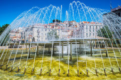 Romantic Lisbon street. Fountain in the center of the city Stock Image