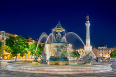 Romantic Lisbon street. Fountain at night in the center Stock Photos