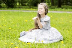 Romantic little child sends kisses through air Royalty Free Stock Images