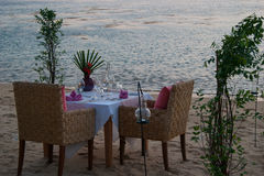 Romantic little table on the seashore, with candles. Stock Images