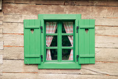 Romantic log cabin. Wooden window with hearts on traditional log cabin Stock Photos