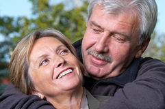 Romantic look. Portrait of a mature couple smiling to each other Stock Photography