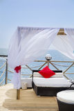 Romantic  lounge sunbed on a wooden pier Stock Photography