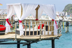 Romantic  lounge sunbed on a wooden pier Stock Images