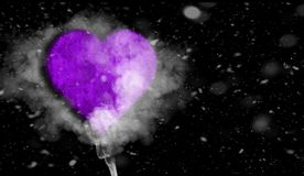 Romantic love purple heart with smoke on background for copy space. With snow texture overlays. Creative Valentine`s Day and Woman Day background . Romantic stock image