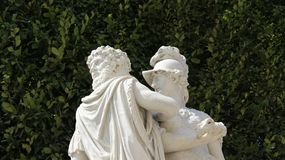 Romantic love Sculpture With Green Fences Backgrounds royalty free stock images