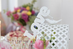 Romantic love sign on a cage with dove and flowers on background Royalty Free Stock Images
