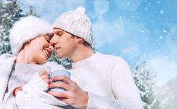 Romantic in love tender kissing couple winter portrait in the sn stock photography