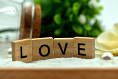 Romantic Love Wood Blocks are on the White Sands Stock Images