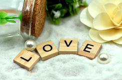 Romantic Love Wood Blocks are on the White Sands Royalty Free Stock Photo