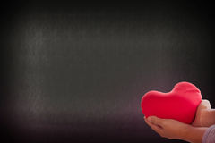Romantic lovely valentine concept with hand gently raise up red. Heart on soft bokeh background Royalty Free Stock Image