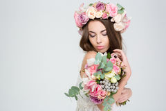 Romantic lovely woman in wreath of roses with flower bouquet Stock Images