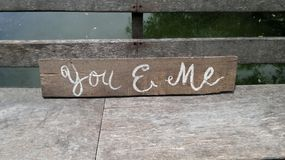 Romantic lover point sign on wooden bridge Stock Image