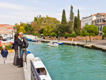 Romantic lovers. On quiet canal in Venice Italy with moored boats at Piazza Roma Royalty Free Stock Photography