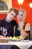 Romantic Lovers in Dinner Date Looking at Camera Stock Images