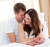 Romantic lovers embracing lying in bed Royalty Free Stock Image