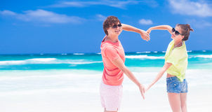 Romantic lovers having fun on a tropical beach. Royalty Free Stock Photos