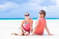 Romantic lovers vacation on a tropical beach. Royalty Free Stock Photography