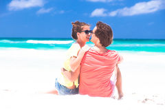 Romantic lovers vacation on a tropical beach. Stock Images
