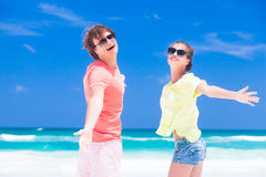 Romantic lovers vacation on a tropical beach. Stock Photography