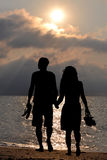 Romantic lovers walking on the beach Royalty Free Stock Image