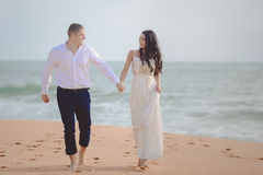Romantic loving couple on the beach Stock Photography