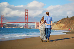 Romantic loving couple having a date on Baker beach in San Francisco Stock Images