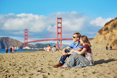 Romantic loving couple having a date on Baker beach in San Francisco Royalty Free Stock Photo