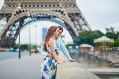 Romantic loving couple having a date near the Eiffel tower Stock Photos