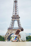 Romantic loving couple having a date near the Eiffel tower Royalty Free Stock Image
