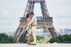 Romantic loving couple having a date near the Eiffel tower Stock Images