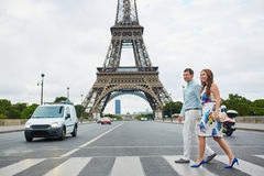 Romantic loving couple having a date near the Eiffel tower Royalty Free Stock Images