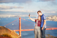 Romantic loving couple making selfie in San Francisco Stock Images