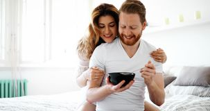 Romantic couple on weekend. Romantic loving couple in morning in bed Stock Images