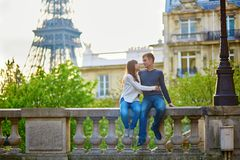 Romantic loving couple near the Eiffel tower Royalty Free Stock Images