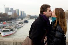 Romantic loving couple in Paris. Kissing at the Iena bridge Stock Images