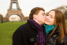 Romantic loving couple in Paris. Kissing near the Eiffel Tower Stock Image